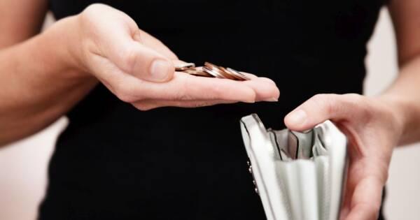 Woman Saving Money in Wallet