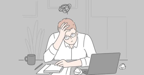 Fatigued Man at Work Desk