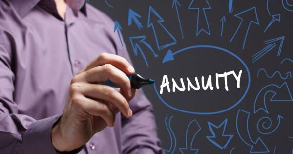 Man Writing Annuity on Clear Screen