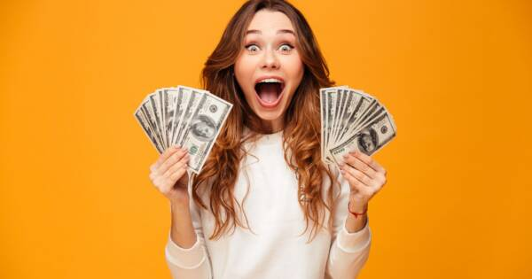 Woman Excited with Hands Full of Cash