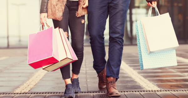 Couple with Shopping Bags at Retailer