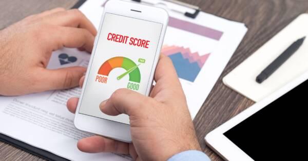 Man Checking Credit Score on Phone