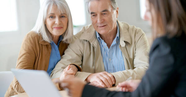 Retiring Couple Discussing Finances with Professional