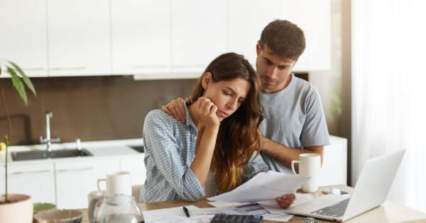 Couple Considering Debt in Kitchen