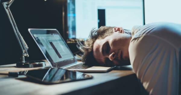 Man Sleeping on Laptop at Work
