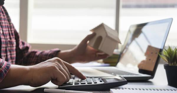 Man Calculating Mortgage