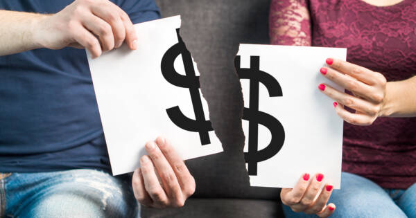 Couple with Money Sign Ripped in Half