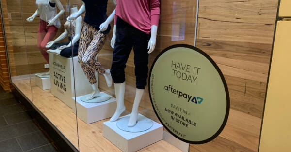 Store Display Window with Buy Now Pay Later Sign