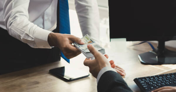 Lender Exchanging Cash with Client