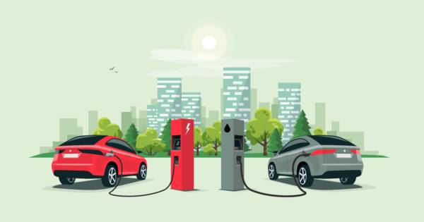 Electric and Gas-Powered Car Fueling Up