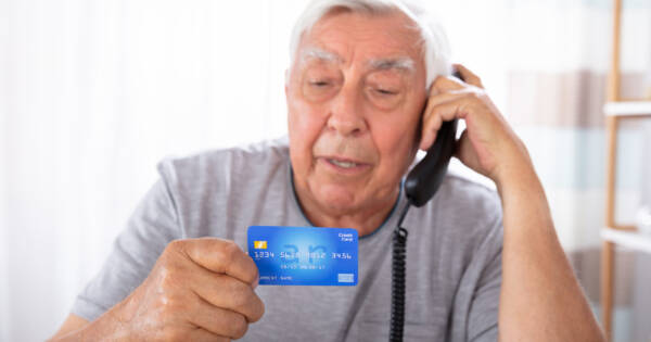 senior falling for credit card scam