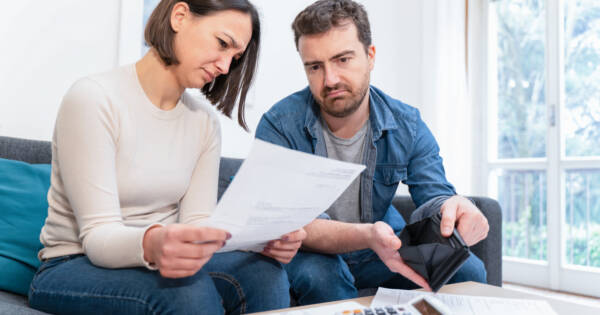 Young couple making a rental budget