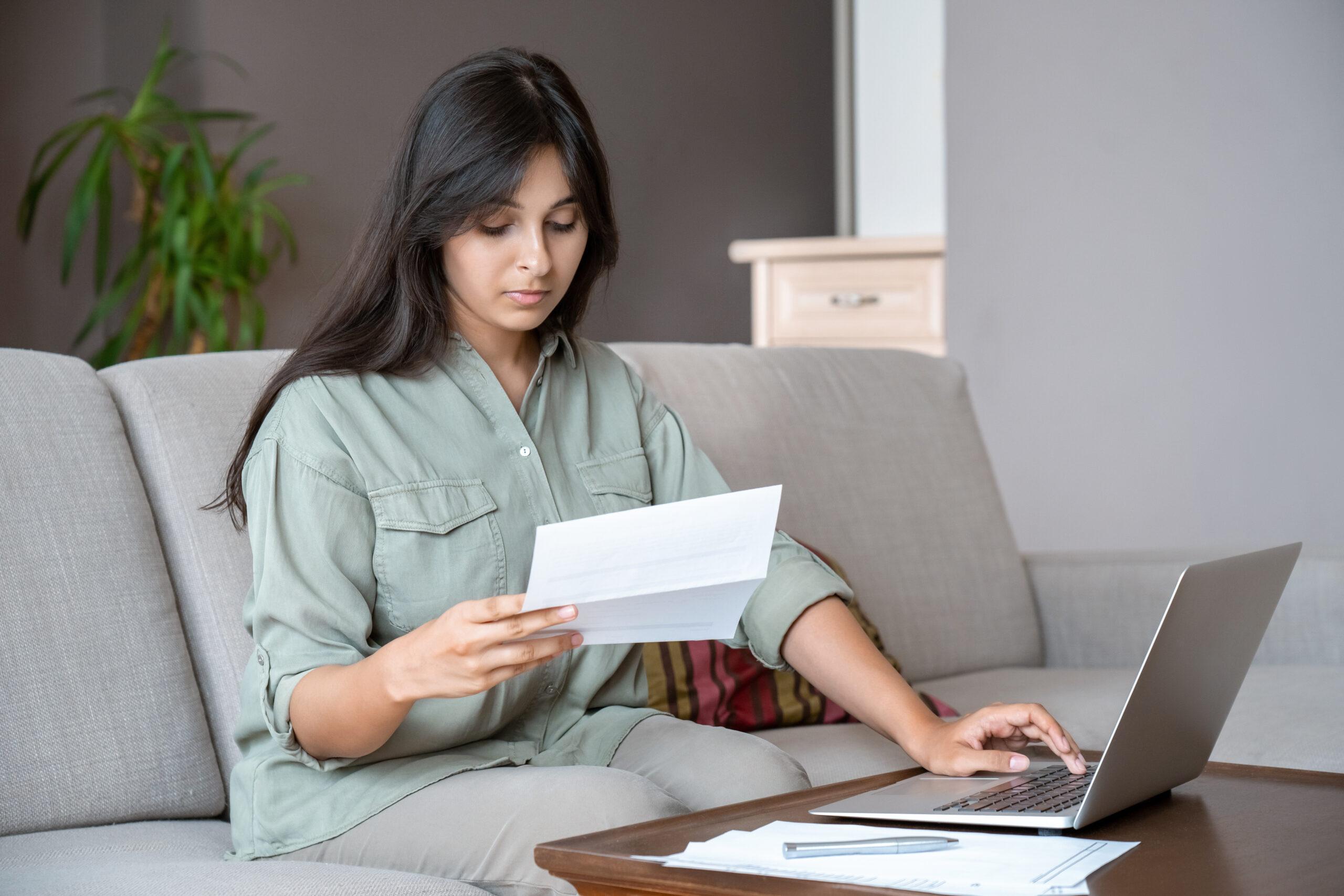 Young woman paying bills